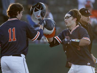 Wakeland High School first baseman Preston Snead (11) congratulates Wakeland High School catcher Blake Morrow (5) at home plate after Morrow hit a home run in the third inning during game one of a best of three Class 5A bi-district playoff series played at McKinney Boyd High School in McKinney on Thursday evening, May 6, 2021. (Stewart F. House/Special Contributor)