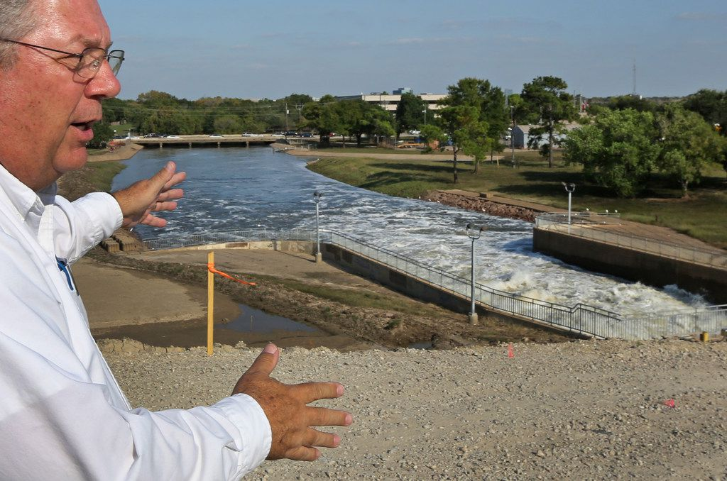 Richard Long of the U.S. Army Corps of Engineers shows where the gates of the Barker Reservoir empty into Buffalo Bayou in West Houston.