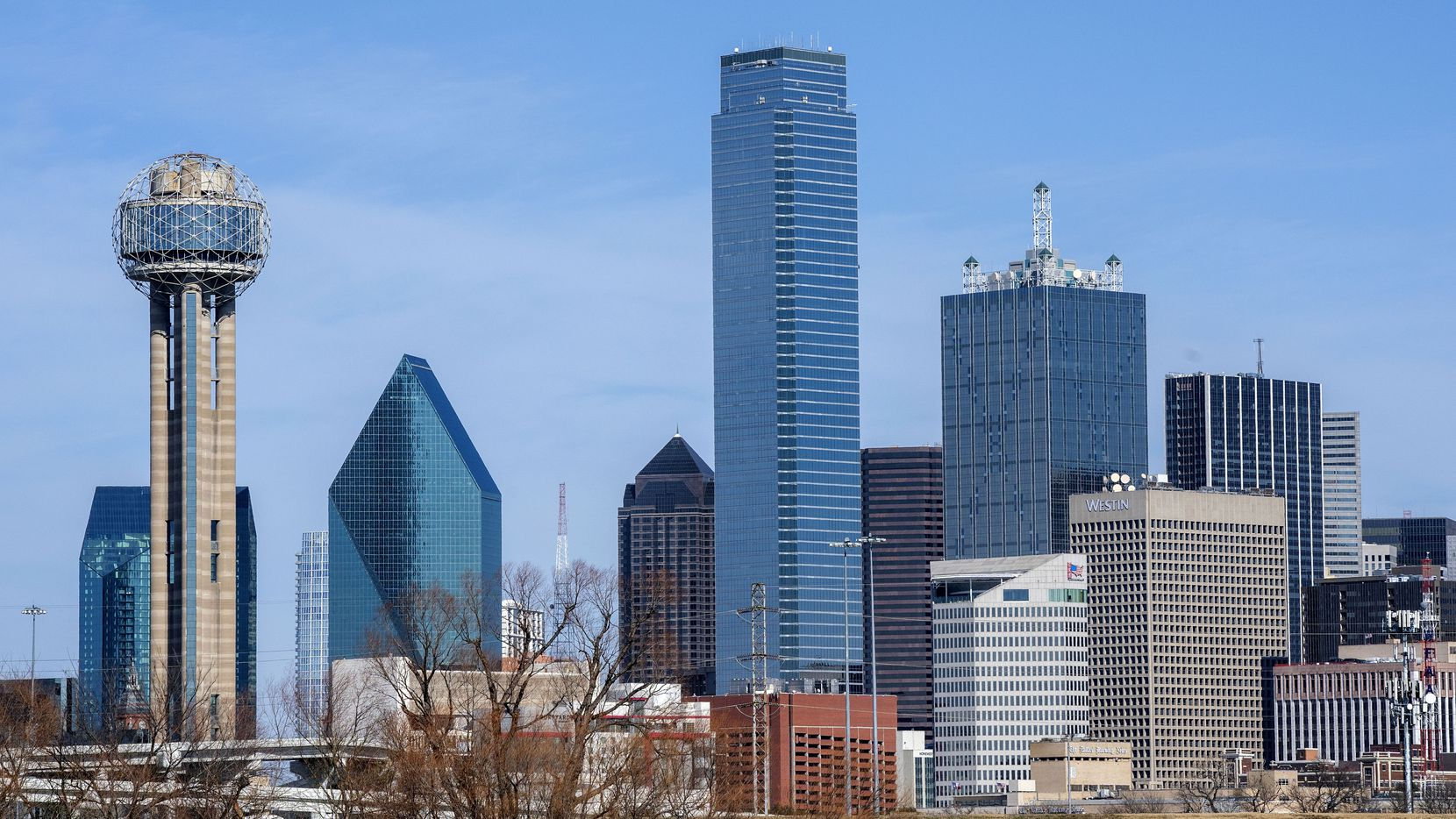 Renaissance Tower (right) stands next to Bank of America Plaza (center) on the Dallas skyline.