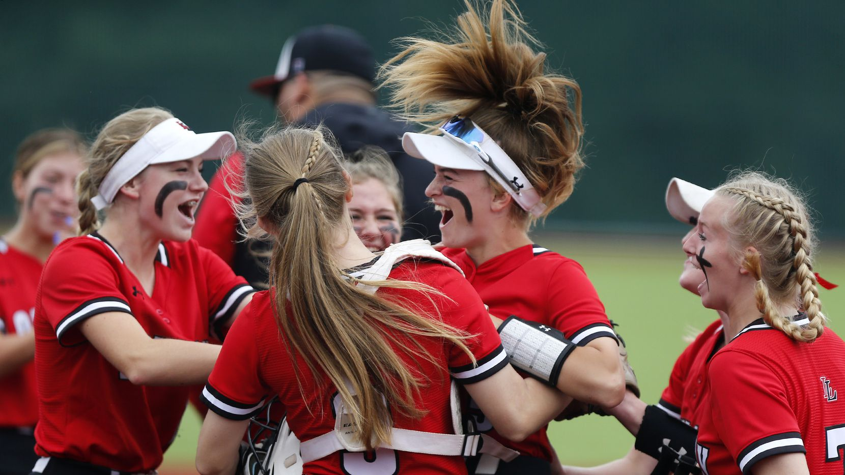 Lovejoy players celebrate with shortstop Skylar Rucker (center) after she tagged out a runner trying to steal in the first inning of Lovejoy's 4-0 win over Frisco Wakeland on Saturday in Game 3 of a best-of-3 Class 5A first-round playoff series.