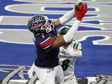 Denton Ryan wide receiver Ja'Tavion Sanders (1) catches a touchdown pass as Cedar Park defensive back Casyn Wiesenhutter (8) defends during the second half of the Class 5A Division I state title game at AT&T Stadium on Friday, Jan. 15, 2021, in Arlington.
