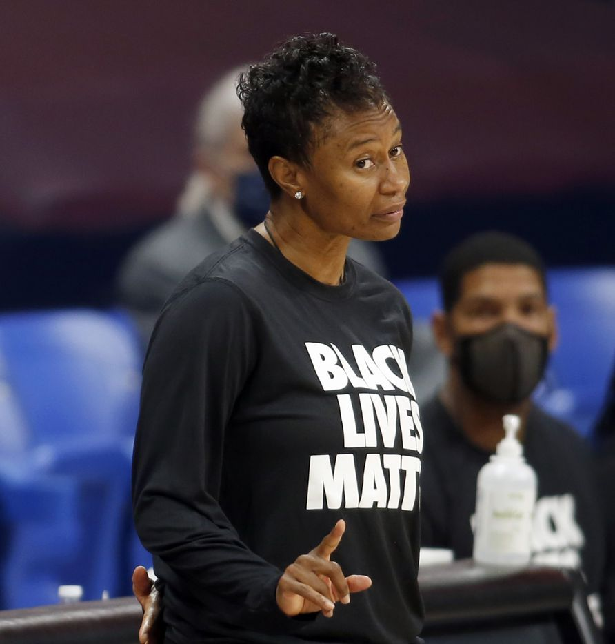 Dallas Wings head coach Vickie Johnson delivers a subtle gesture to guard Allisha Gray (15) after she was called for her 2nd foul during the first quarter of play against the Minnesota Lynx. The two teams played their WNBA game at College Park Center on the campus of the University of Arlington on June 17, 2021(Steve Hamm/ Special Contributor)