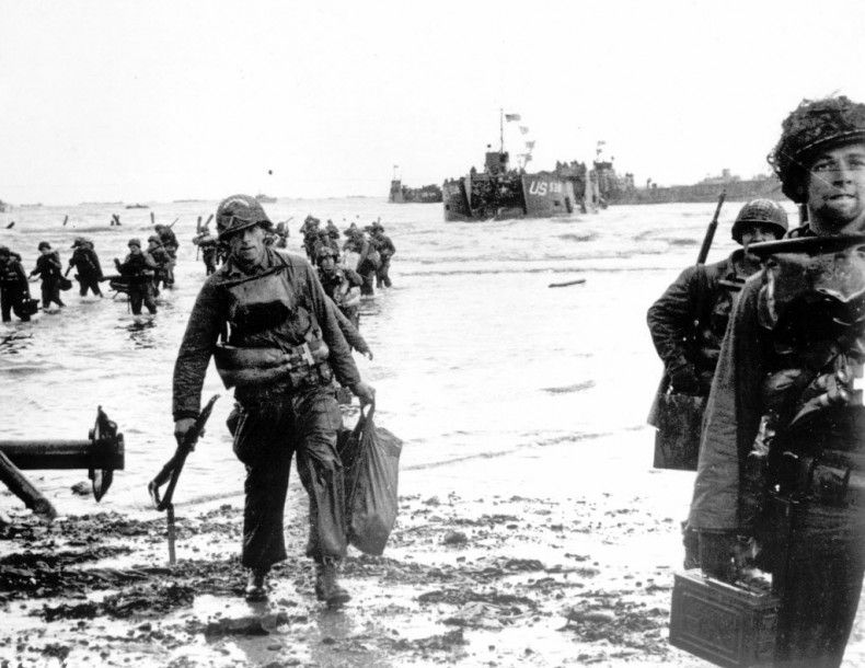 Carrying full equipment, American assault troops move onto a beachhead code-named Omaha Beach, on the northern coast of France, in this June 6, 1944 file photo, during the Allied invasion of the Normandy coast.
