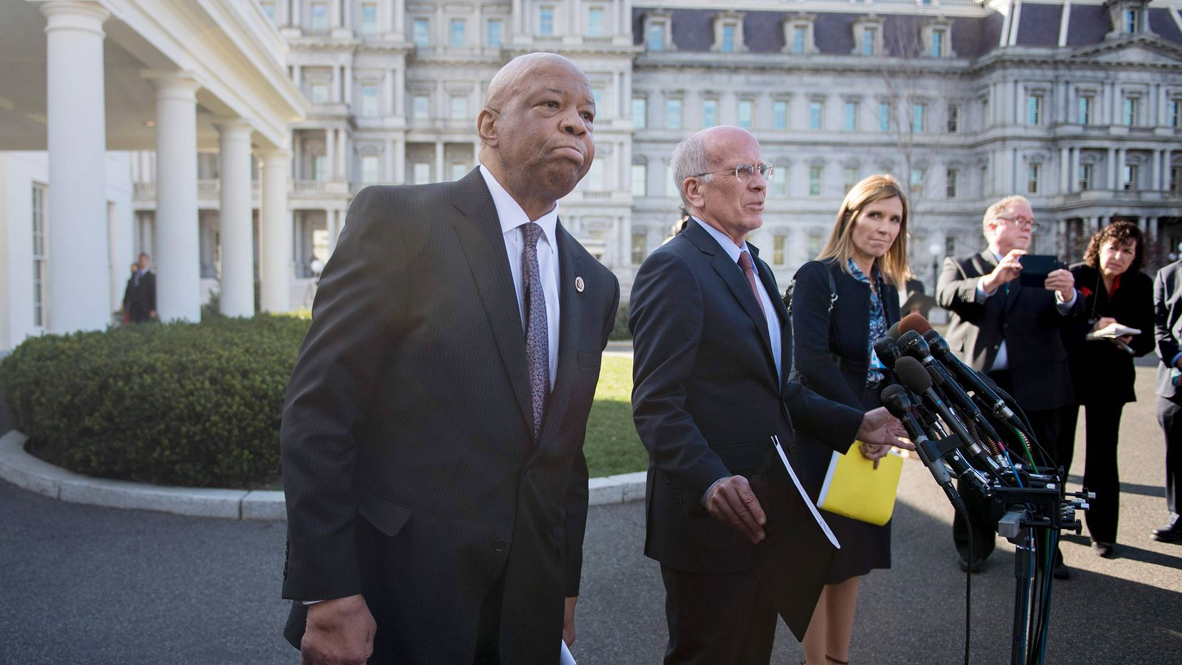 US Congressman Elijah Cummings (L), D-Maryland, and US Congressman Peter Welch (C), D-Vermont, speak at the White House in Washington, DC, March 8, 2017, after a meeting with US President Donald Trump.