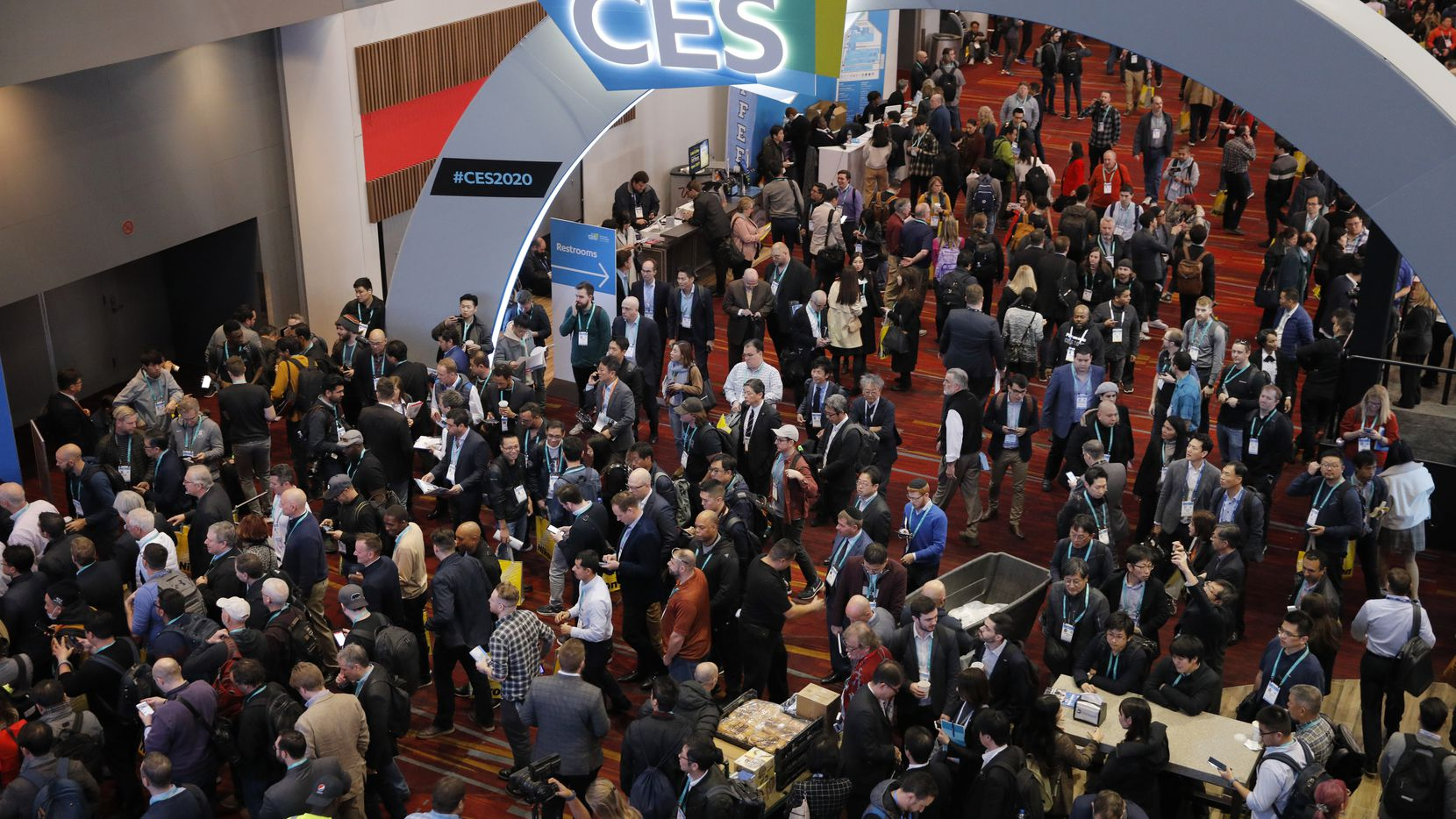 Crowds enter the convention center at the CES tech show in Las Vegas. (AP Photo/John Locher)