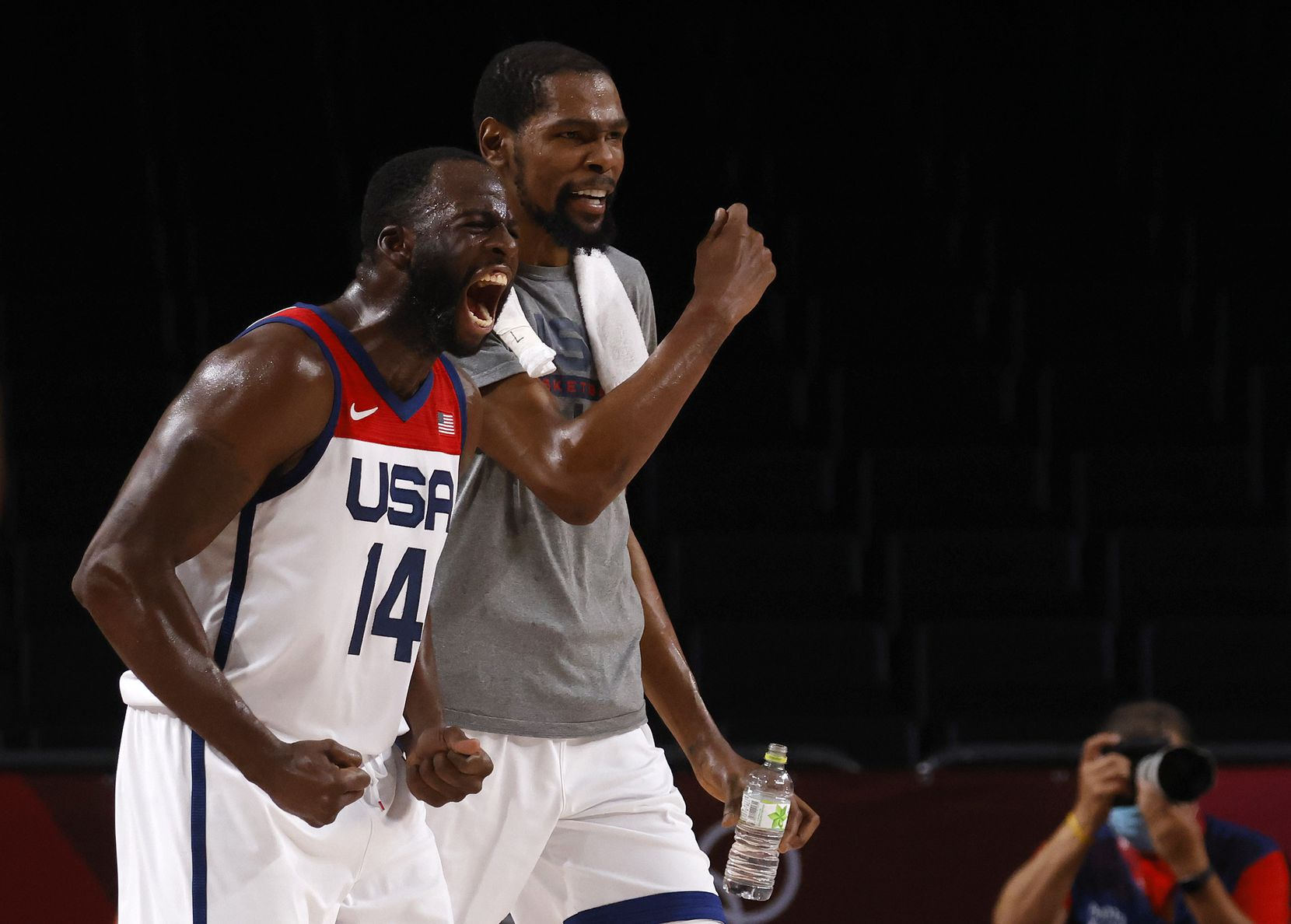 USA's Draymond Green (14) and Kevin Durant (7) celebrate a made basket in a game against Australia during the second half of a men's basketball semifinal at the postponed 2020 Tokyo Olympics at Saitama Super Arena, on Thursday, August 5, 2021, in Saitama, Japan. USA defeated Australia 97-78 to advance to the gold medal game. (Vernon Bryant/The Dallas Morning News)