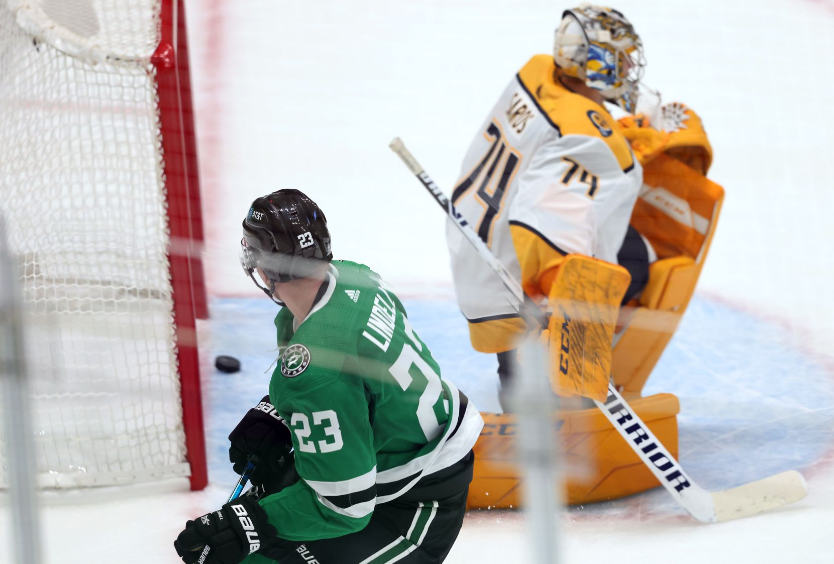 Dallas Stars defenseman Esa Lindell (23) watches his shot pass Nashville Predators goaltender Juuse Saros (74) for a goal during the second period of play in the Stars home opener at American Airlines Center on Friday, January 22, 2021in Dallas. (Vernon Bryant/The Dallas Morning News)