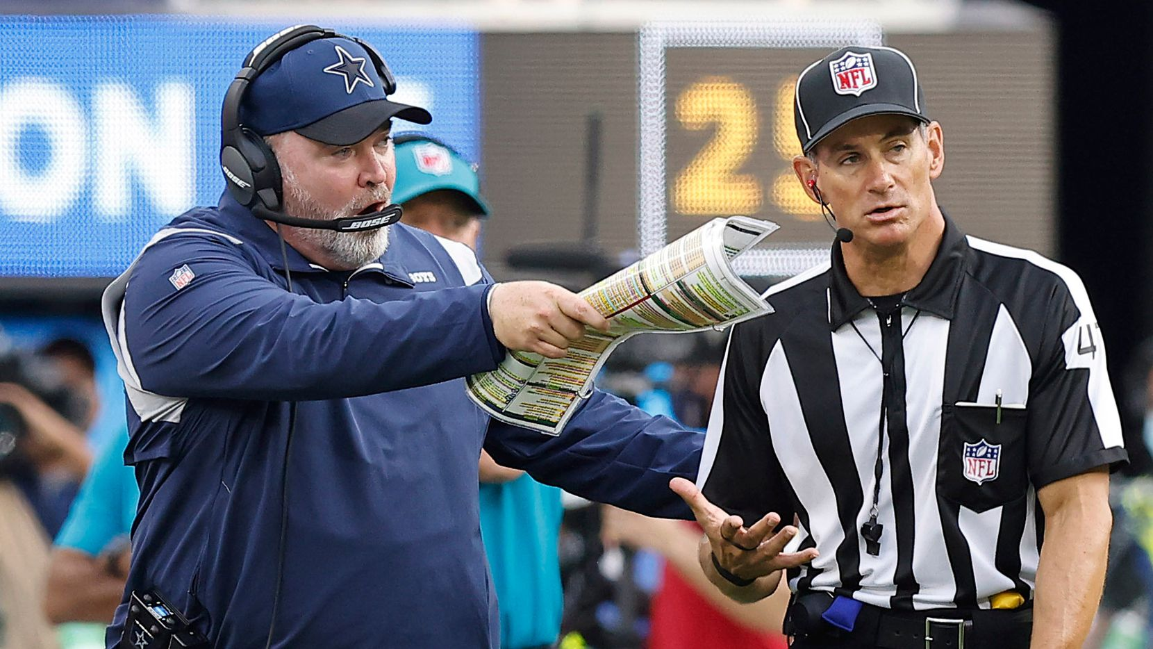 Dallas Cowboys head coach Mike McCarthy questions a call with the side judge during the third quarter against the Los Angeles Chargers at SoFi Stadium in Inglewood, California, Sunday, September 19, 2021.