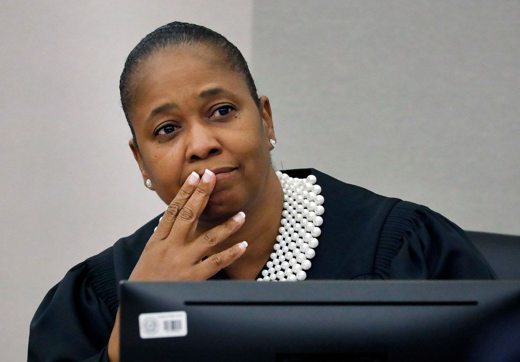 Judge Tammy Kemp patiently listens to to defense attorneys debate exhibits to be entered as evidence at Amber Guyger's murder trial in the shooting death of Botham Jean last year.