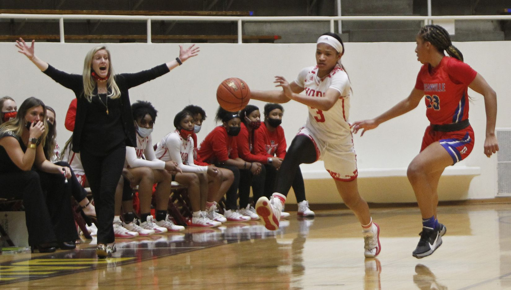 Mesquite Horn head coach Whitney Long works to inspire her players as Lady Jag guard Jasmine Shavers (3) kicks into another gear as she drives past the defense of Duncanville guard Nyah Wilson (33) during first half action. The two teams played their Class 6A area-round playoff basketball game at Loos Field House in Addison on February 23, 2021. (Steve Hamm/ Special Contributor)