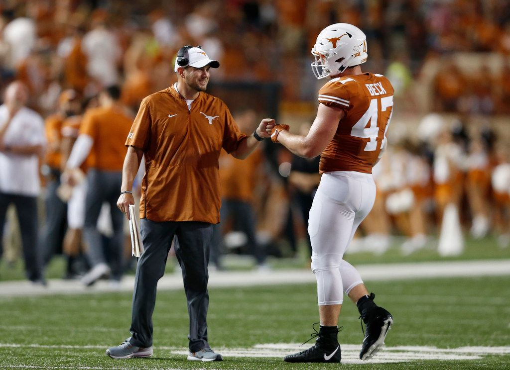 AUSTIN, TX - SEPTEMBER 08:  Head coach Tom Herman of the Texas Longhorns congratulates Andrew Beck #47 of the Texas Longhorns in the fourth quarter against the Tulsa Golden Hurricane at Darrell K Royal-Texas Memorial Stadium on September 8, 2018 in Austin, Texas.  (Photo by Tim Warner/Getty Images)