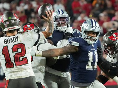 Tampa Bay Buccaneers quarterback Tom Brady (12) throws a pass under pressure from Dallas Cowboys linebacker Micah Parsons (11) during the second half of an NFL football game at Raymond James Stadium on Thursday, Sept. 9, 2021, in Tampa, Fla. The  Buccaneers won the game 31-29. (Smiley N. Pool/The Dallas Morning News)