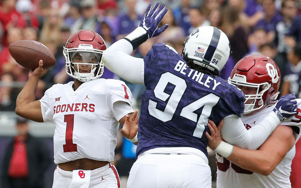 Oklahoma Sooners quarterback Kyler Murray (1) gets a pass off under pressure from TCU Horned Frogs defensive tackle Corey Bethley (94) in the first quarter during the Oklahoma Sooners vs. the TCU Horned Frogs NCAA football game at Amon G. Carter Stadium in Fort Worth, Texas on Saturday, October 20, 2018. (Louis DeLuca/The Dallas Morning News)