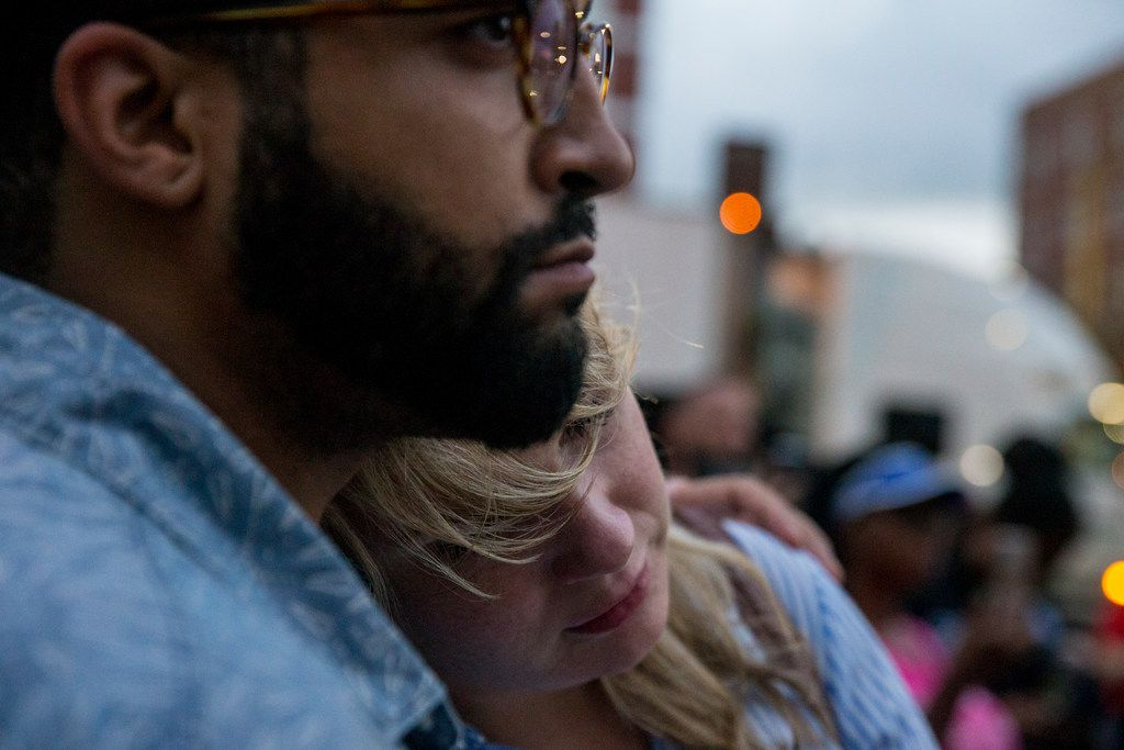Lloyd Harvey holds onto Alyssa Kinsey during a Mothers Against Police Brutality candlelight vigil for Botham Shem Jean at the Jack Evans Police Headquarters on Friday, September 7, 2018 in Dallas. He was shot by a Dallas police officer who mistook his apartment for hers on Thursday night. (Shaban Athuman/ The Dallas Morning News) ORG XMIT: 20041716A