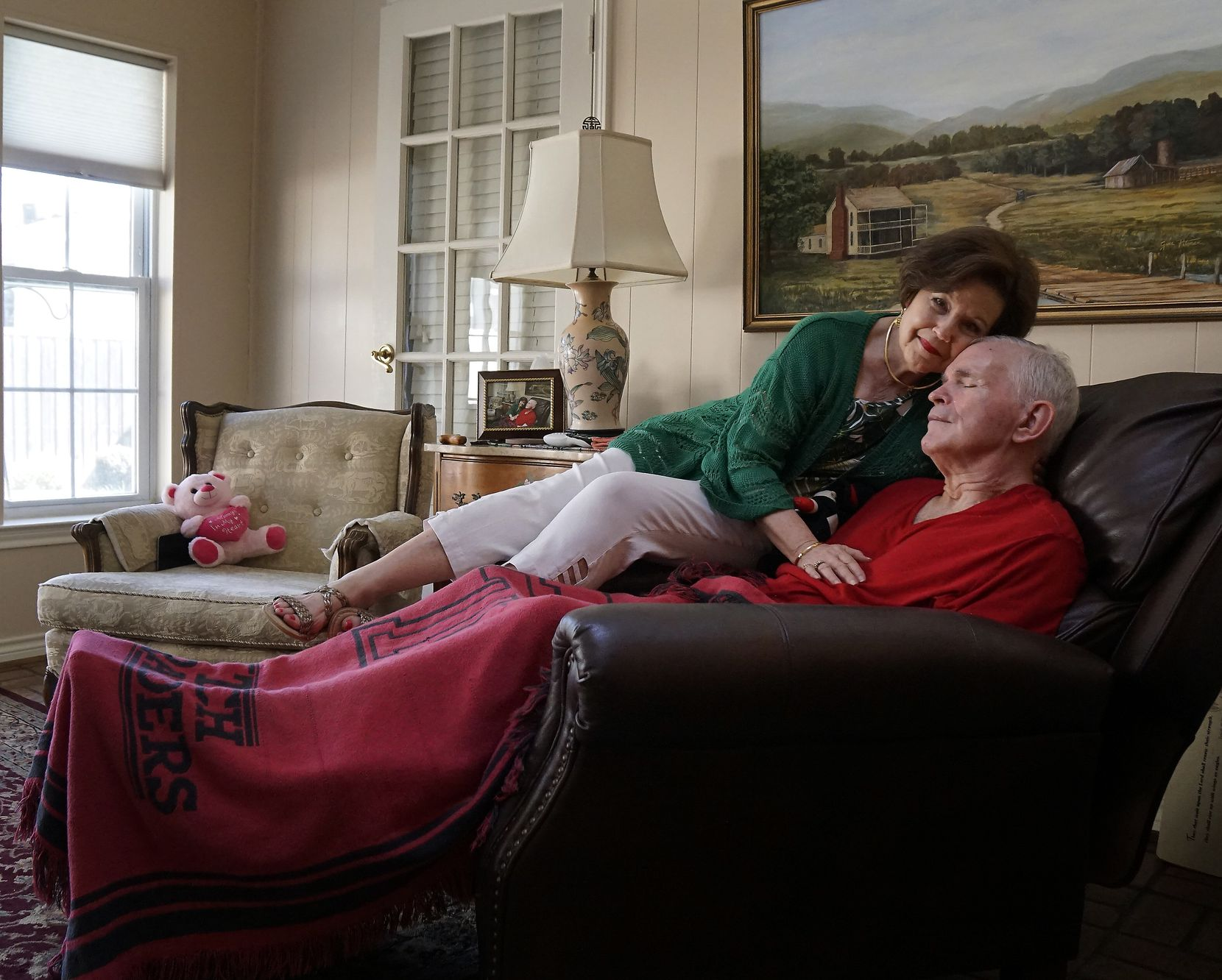 Dianne Bryant sits with her husband, Marc, who suffers from Lewy Body dementia at their home in Dallas, Texas on July 31, 2019.
