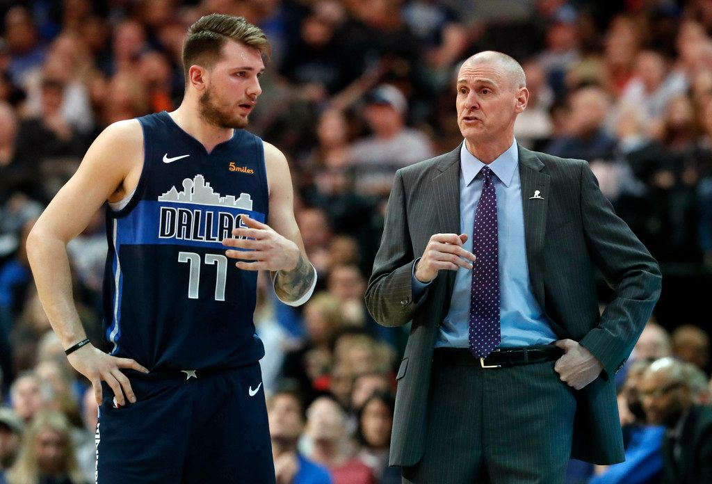 Dallas Mavericks forward Luka Doncic (77) listens to head coach Rick Carlisle on the sideline during the first half of an NBA basketball game against the Toronto Raptors in Dallas, Sunday, Jan. 27, 2019.