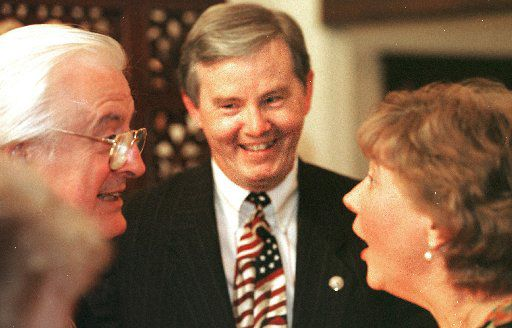 In this file photo, Rep. Joe Barton prepares to take photos with supporters at a fundraiser in Arlington. (Photo by Billy Smith)
