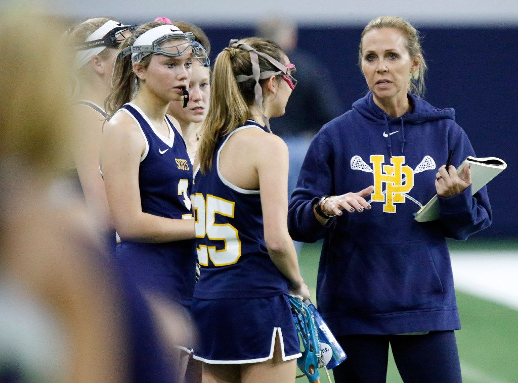 Highland Park head coach Lellie Swords (right) talks to Rebekah Miller (25) near the end of the first half as Highland Park played the Frisco Fury as part of the Patriot Cup lacrosse tournament at The Ford Center at The Star in Frisco on Saturday, February 18, 2017. (Stewart F. House/Special Contributor)