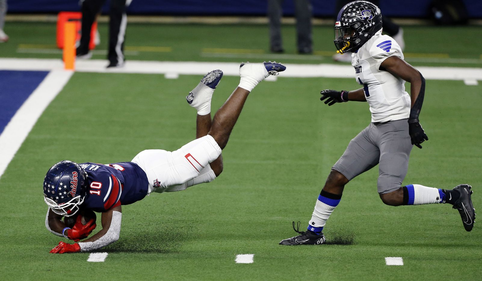 Denton Ryan's Kalib Hicks (10) dives for the end zone, but comes up a yard short, as Mansfield Summit's Jalon Rock (4) trails during the first half of the Class 5A Division I state semifinal football playoff game at AT&T Stadium in Arlington on Friday, January 8, 2021. (John F. Rhodes / Special Contributor)
