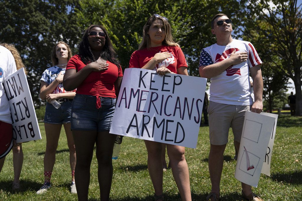 WASHINGTON, DC - JULY 07: People sing the national anthem during the March For Our Rights rally, promoting Second Amendment Rights and the safety of students in schools outside the U.S. Capitol on July 7, 2018 in Washington, DC. Rallies are being held across the country as a reaction to the student-led gun control movement started after the Parkland school shooting. (Photo by Toya Sarno Jordan/Getty Images)