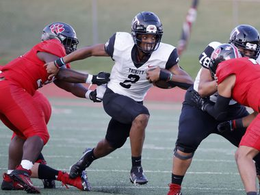 Colleyville defender Elijah Omar (left) tries to stop Euless Trinity quarterback Ollie Gordon (2) during the first half of a high school football game in Grapevine, Texas on Friday, Sept. 10, 2021. (Michael Ainsworth/Special Contributor)