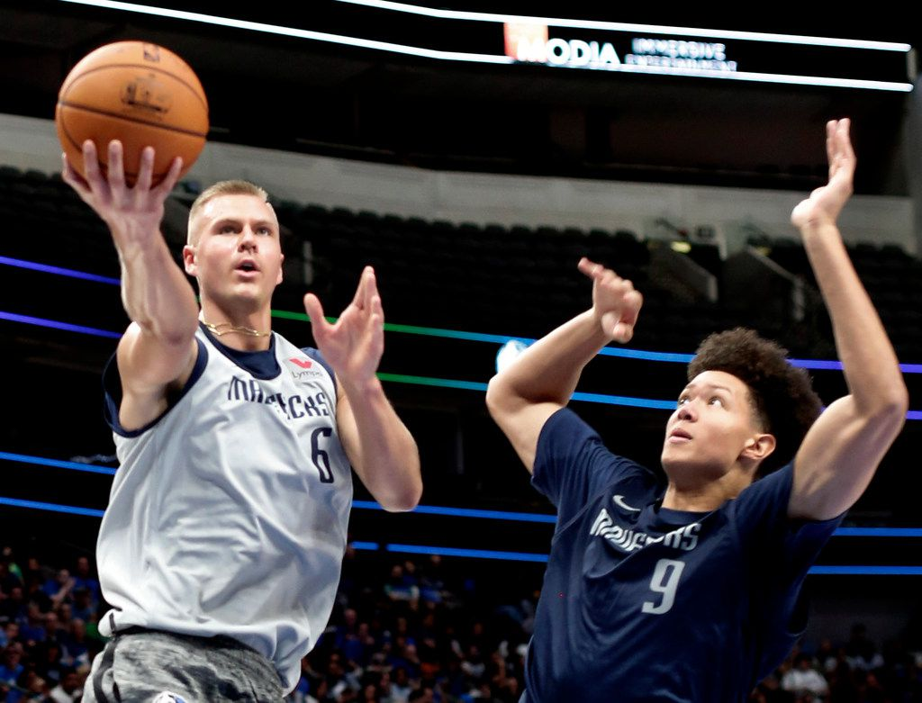 Dallas Mavericks center Kristaps Porzingis (6) drives to the basket past forward Isaiah Roby (9) during an intra-squad scrimmage. The Mavericks held an open practice, inviting fans to attend an intra-squad basketball scrimmage at the American Airlines Center in Dallas on October 6, 2019. (Steve Hamm/ Special Contributor)