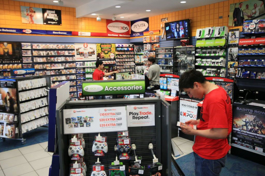 George Nunez, 17, looks at an XBOX 360 video game while browsing the GameStop store at NorthPark Center, on May 23, 2013 in Dallas. Ben Torres/Special Contributor