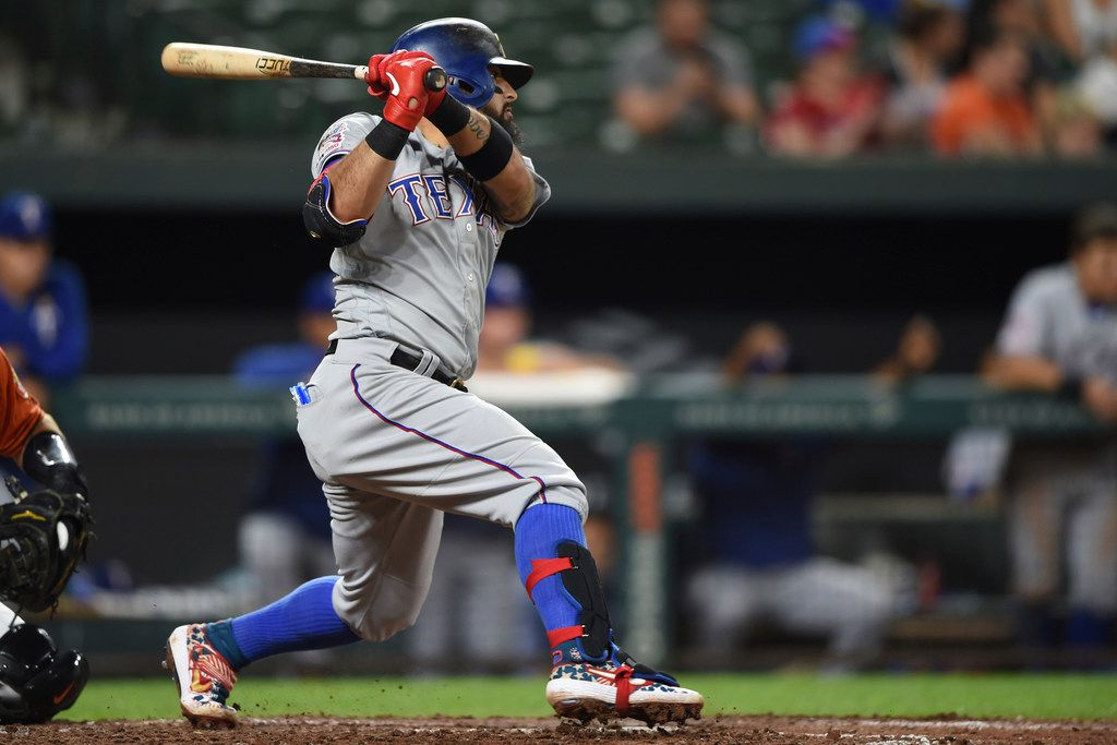 Texas Rangers Rougned Odor follows through on a double against the Baltimore Orioles in the seventh inning of a baseball game, Saturday, Sept. 7, 2019, in Baltimore. The Rangers won 9-4.(AP Photo/Gail Burton)