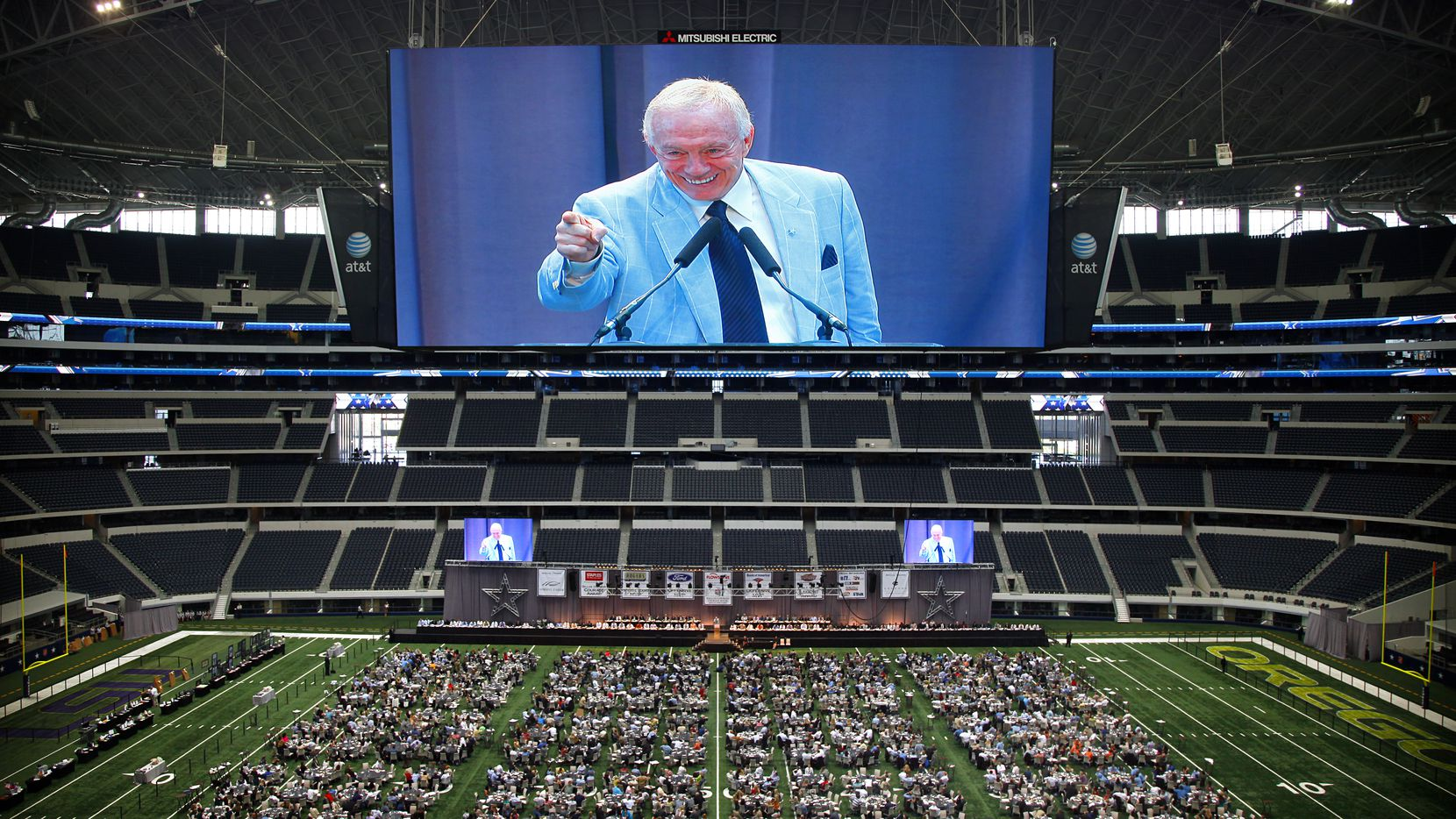 Dallas Cowboys owner Jerry Jones, on the center hung video board, delivers his preseason message to those in attendance at the 2011 Dallas Cowboys Luncheon on the field of Cowboys Stadium, Wednesday, August 31, 2011. The event benefits The Dallas Cowboys Courage House located at Happy Hill Farm.  (Tom Fox/The Dallas Morning News)
