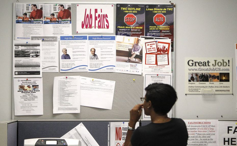 A job seeker looks at a bulletin at the Texas Workforce Commission's Workforce Solutions of Greater Dallas job resource center. (AP Photo/LM Otero)