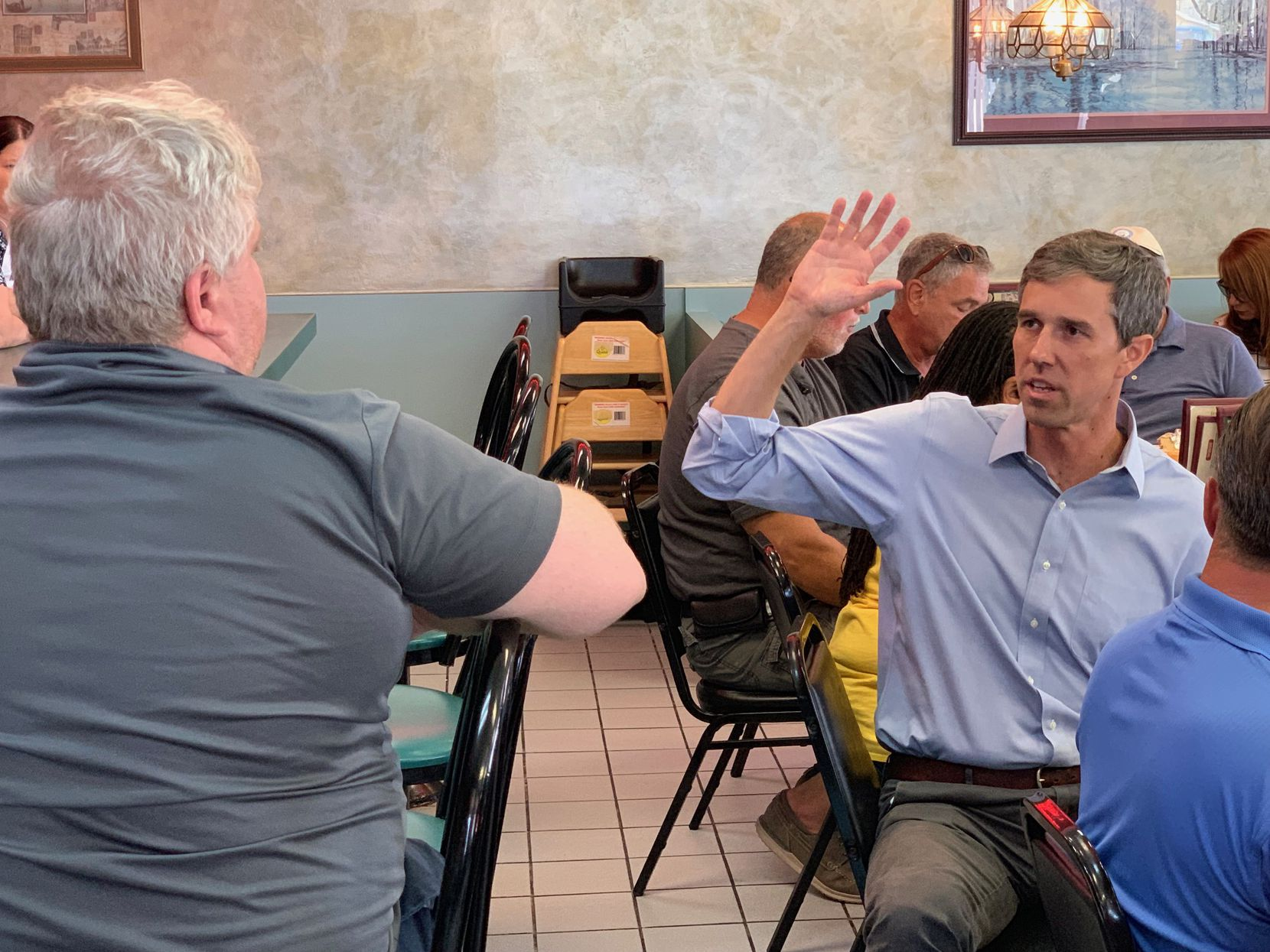 Democratic presidential candidate Beto O'Rourke talks to a potential voter at John's Family Grill in Mount Clemens, Mich.