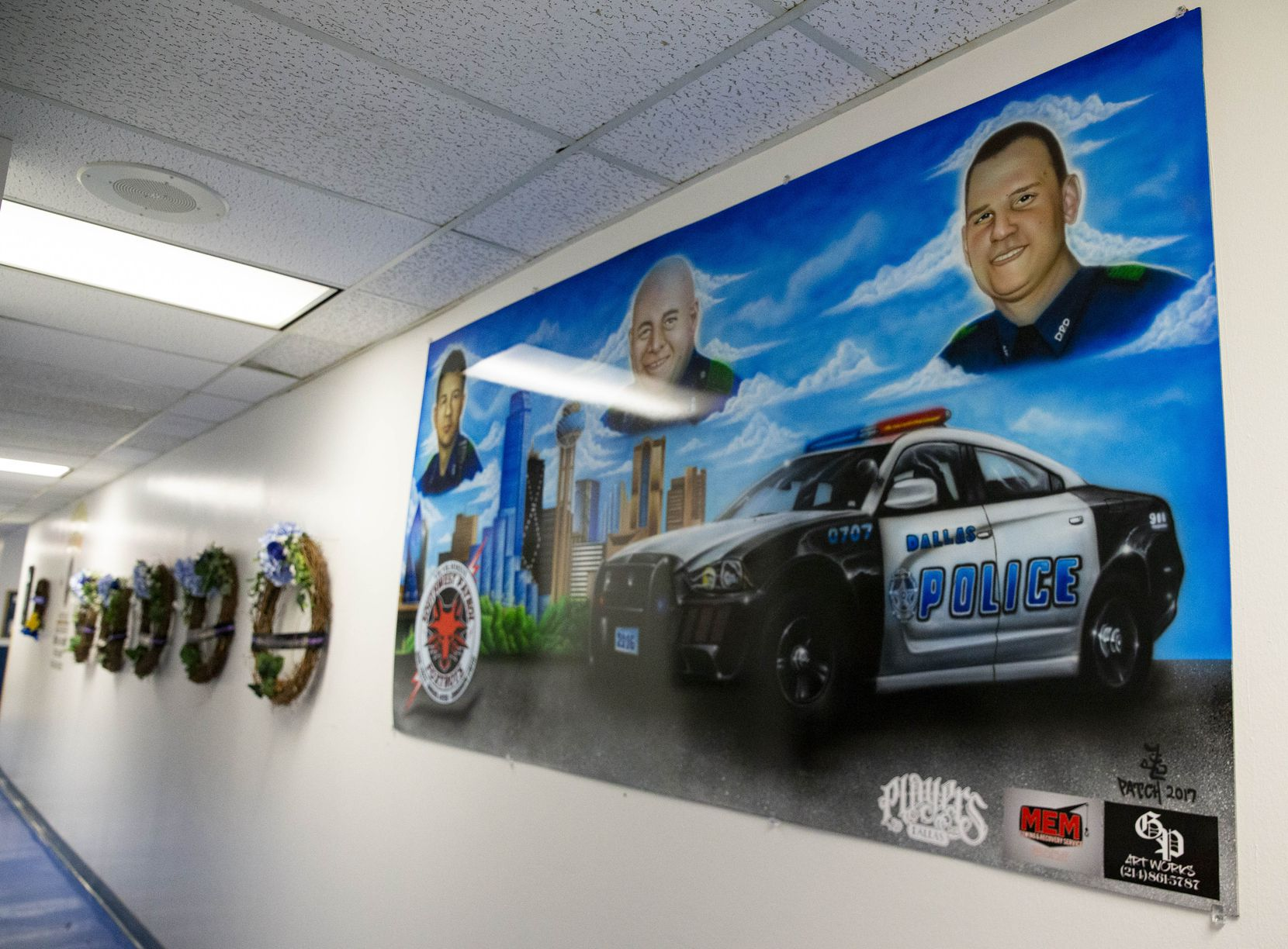 A painting dedicated to the three of the five Dallas police officers who were killed when a gunman ambushed an evening of protests in downtown Dallas in 2016, photographed on Friday, July 2, 2021, at the DPD Southwest Patrol division in Dallas.