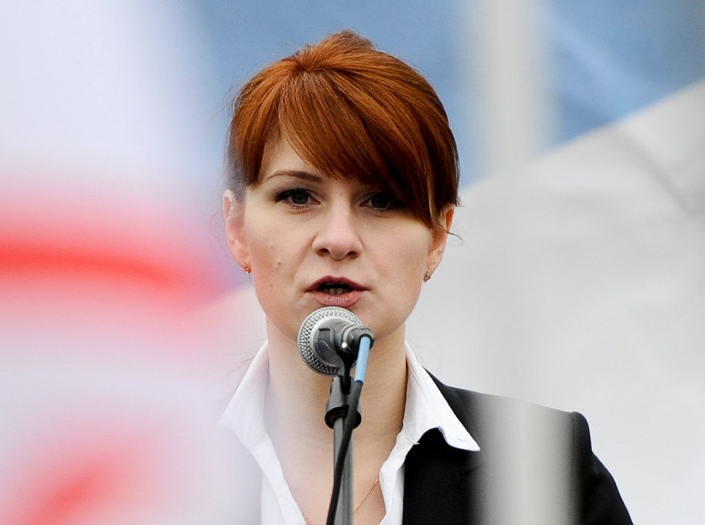FILE - In this April 21, 2013, file photo, Maria Butina, leader of a pro-gun organization in Russia, speaks to a crowd during a rally in support of legalizing the possession of handguns in Moscow, Russia. Butina, accused of being a secret agent for the Russian government appears to be coming closer to a plea deal with U.S. prosecutors or other resolution of her criminal case. (AP Photo)