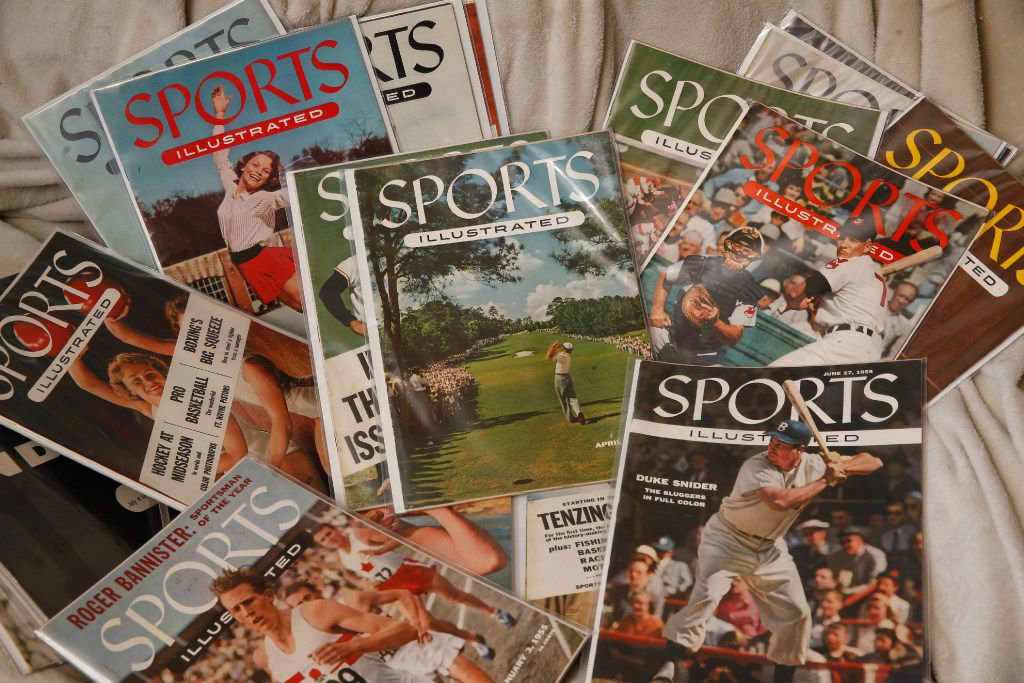 Alan Hairston and Jacqui Dean paid $330 for a storage bin and found a treasure trove of sports memorabilia, including vintage Sports Illustrated magazines, valued at 100,000 by Heritage Auctions in Allen, Texas on April 6, 2017. (Nathan Hunsinger/The Dallas Morning News)
