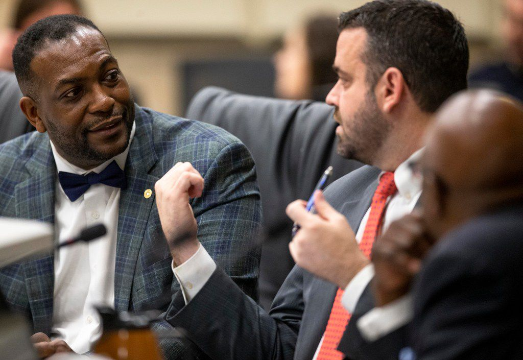 Mayor Pro Tem Casey Thomas, II (left) talks to City Council member Adam McGough during a previous juvenile curfew public hearing at Dallas City Hall on Wednesday, Feb. 6, 2019. (Shaban Athuman/The Dallas Morning News)