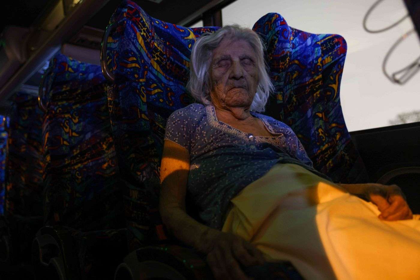 Maria Barajas, who is 100 years old and suffers from dementia, sleeps on the bus that serves as a warming center at Pleasant Oaks Recreation Center on Wednesday, February 18, 2021 in Dallas.