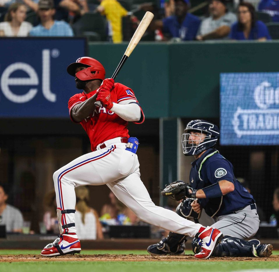 Texas Rangers Adolis Garcia (53) hits a homerun against Seattle Mariners during the sixth inning at Globe Life Field in Arlington, Texas, Friday, July 30, 2021. (Lola Gomez/The Dallas Morning News)