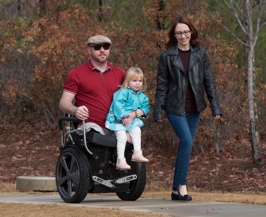 Aaron and Kat Causey with their soon to be three year old daughter Alexandra Jayne (A.J.) at home just outside of Birmingham, Al. Nov. 30, 2016. Causey suffered genital injuries and lost both legs and some fingers and suffered a traumatic brain injury while on active duty in the U.S. Army in Afghanistan in 2011.