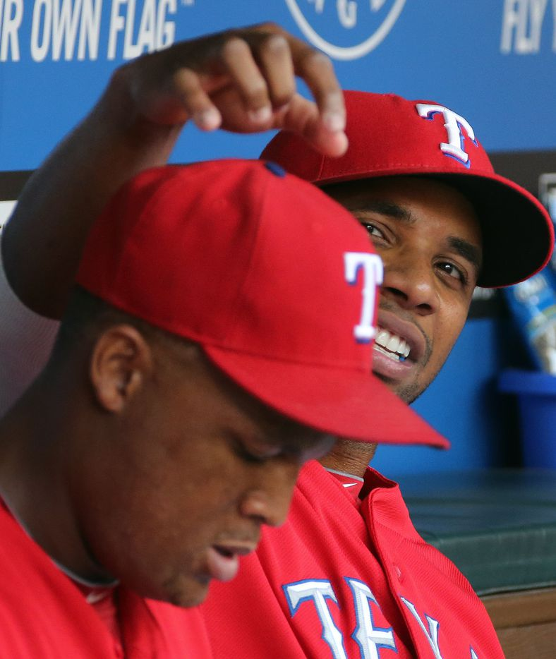 Texas shortstop Elvis Andrus playfully bothers teammate Adrian Beltre on the bench in the dugout during the Los Angeles Angels vs. the Texas Rangers major league baseball game at Rangers Ballpark in Arlington on Monday, July 29, 2013.  (Louis DeLuca/Dallas Morning News)