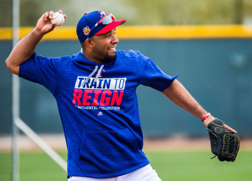Texas Rangers shortstop Elvis Andrus (1) throws to first base during a spring training workout at the teams' training facility on Monday, February 27, 2017 in Surprise, Arizona. (Ashley Landis/The Dallas Morning News)