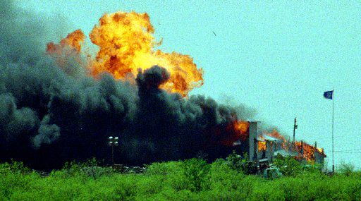 The Branch Davidian compound is rocked by an explosion after the Davidians set fire to it in response to being gassed by federal authorities on April 19, 1993.