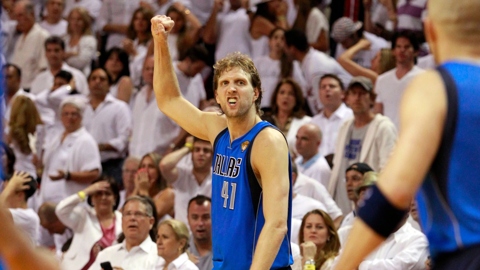 Dallas Mavericks power forward Dirk Nowitzki (41) reacts after they defeated the Miami Heat in Game 2 of the NBA Finals at American Airlines Arena Thursday, June 2, 2011 in Miami. Dallas won the game 95-93.