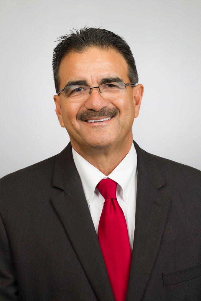 Dallas athletic director Gil Garza