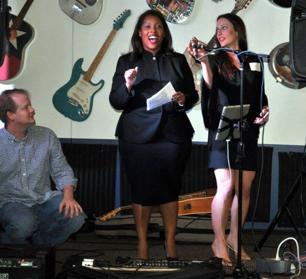 Civil district court judge candidate Bridgett Whitmore (left) speaks on stage alongside lawyer Julie Pettit during a campaign kickoff at Babb Brothers BBQ on Nov. 7, 2017.