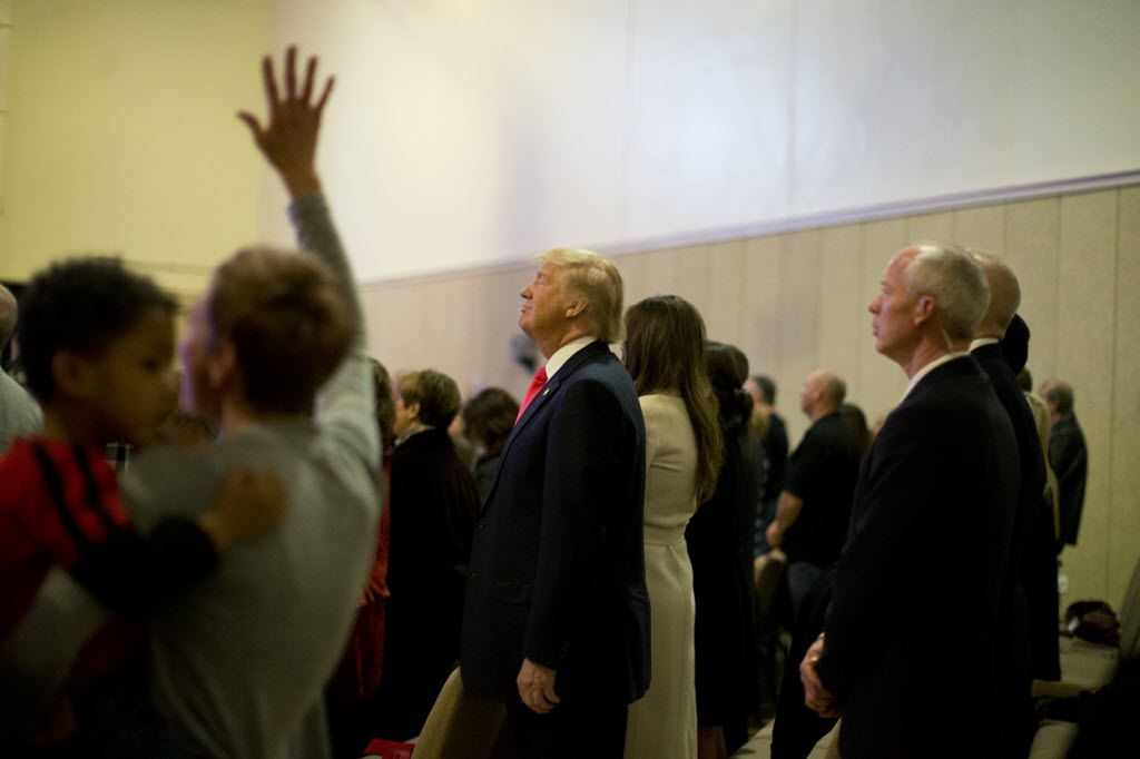 Republican presidential candidate Donald Trump, center, attends a Sunday service with his wife, Melania, at First Christian Church Sunday, Jan. 31, 2016, in Council Bluffs, Iowa. (AP Photo/Jae C. Hong)