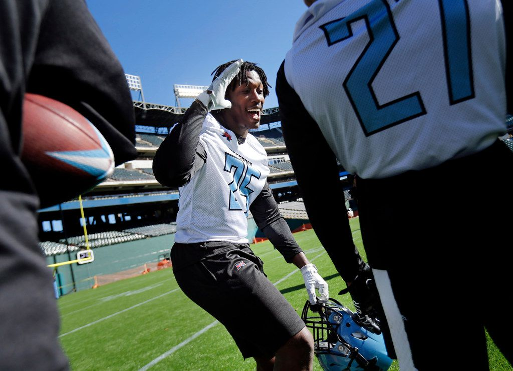 Dallas Renegades running back Lance Dunbar (25) laughs with teammates during a break in practice at Globe Life Park in Arlington, Texas, Saturday, February 1, 2020. Dunbar is a former Dallas Cowboys player who played at the University of North Texas. He will make his XFL debut in the season opener February 9. (Tom Fox/The Dallas Morning News)