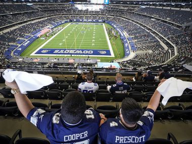 Dallas Cowboys fans Fernando (left) and Emmanuel Lopez of Abilene wave towels during the first quarter of an NFL football game against the Atlanta Falcons at AT&T Stadium on Sunday, Sept. 20, 2020, in Arlington.