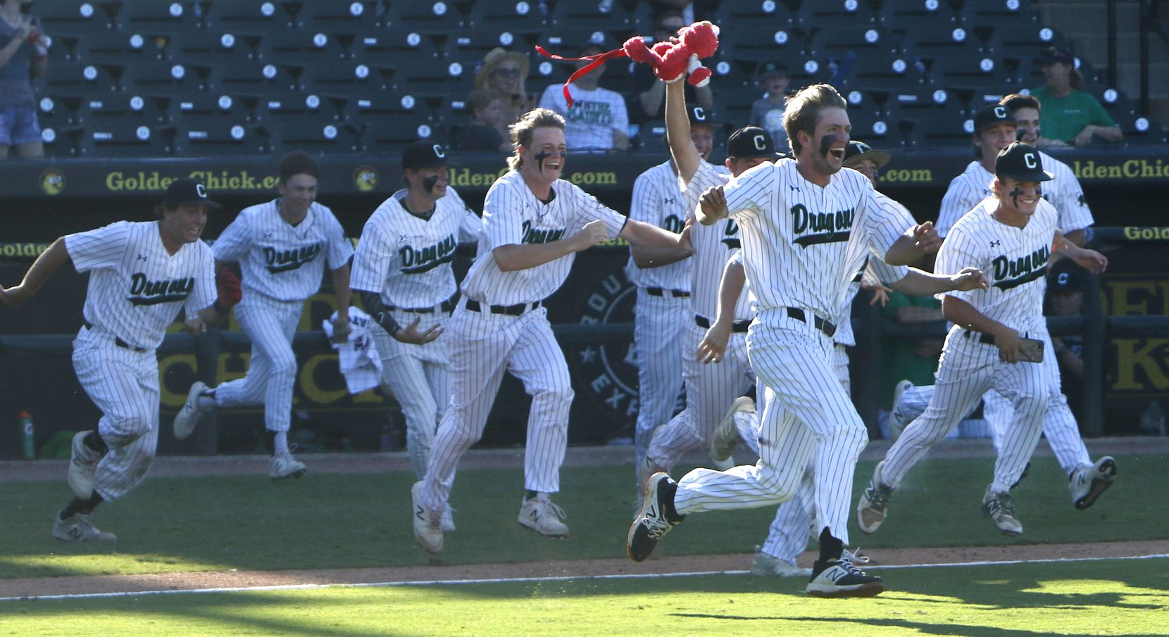 Members of the Southlake Carroll Dragons bolt onto the field following the final out in their 17-0 victory over Fort Bend Ridge Point to claim their 2nd consecutive state championship. The two teams played in the Class 6A state championship baseball game at Dell Diamond in Round Rock on June 8, 2019.