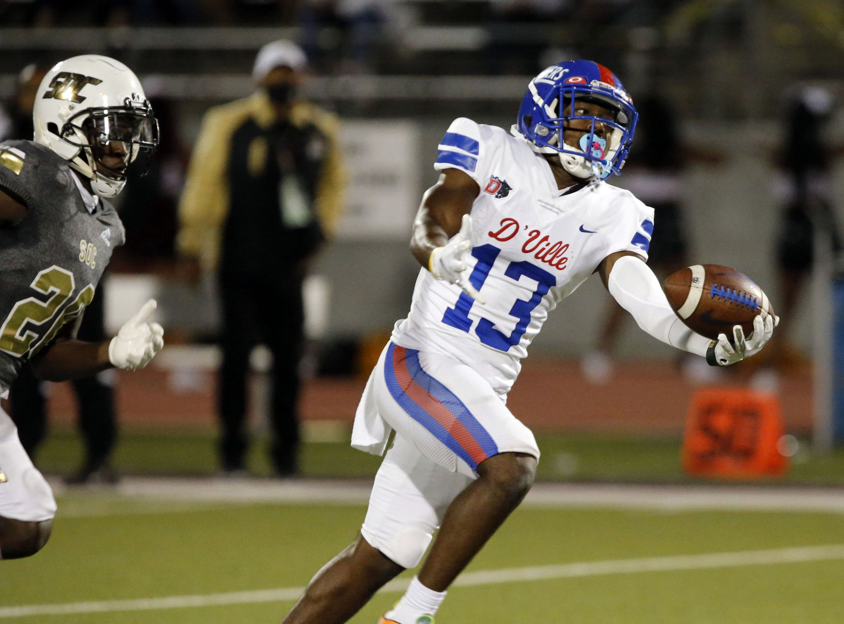 Duncanville WR Roderick Daniels, Jr. (13) makes a one-hand catch over South Oak Cliff' defender Kyron Chambers (20) to setup a touchdown during the first half of high school football game at Kincaide Stadium in Dallas on Friday, October 3, 2020.