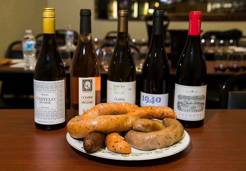 Various samples of boudin paired with wines during a boudin and wine tasting.